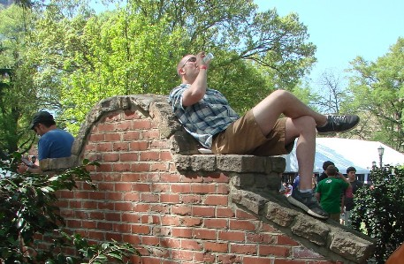 Man drinking beer on a wall
